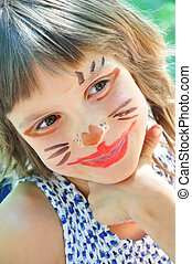 happy child with funny painted face - happy smiling child...