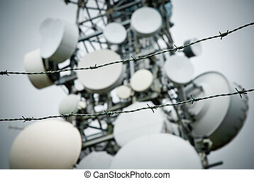 telecommunications towers - barbed wire protecting a...