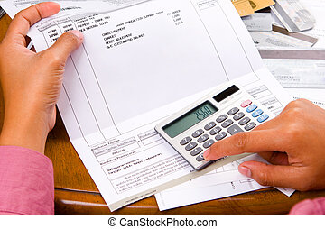 Bills calculation - a woman calculation all the bills she...