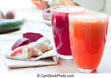 Two glasses of healthy juice - Beet, Apple, Carrot, Ginger...