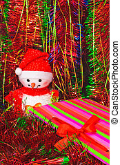 Christmas decorations and tinsel in different colors -...