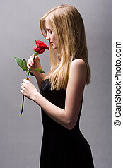 Romantic blond with red rose. - Moody portrait of romantic...