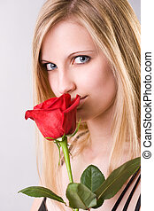 Attractive young blond with fresh rose. - Portrait of an...