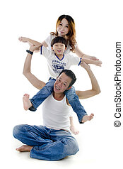 Happy Asian family stacking on white background