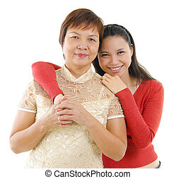 Pan Asian family - Mixed race daughter hugging her mother...