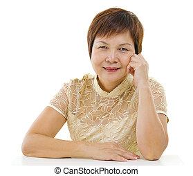 Asian mature woman - 50s mixed race Asian mature woman...