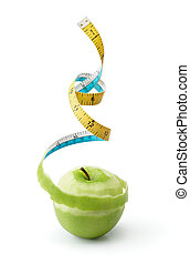 green apple - peel of granny smith turned into tape measure