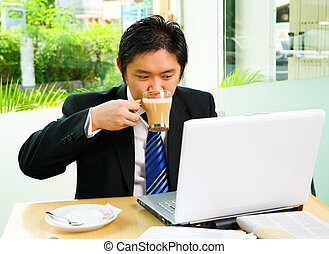 Drinking cofee while working in cafe - Situated inside the...