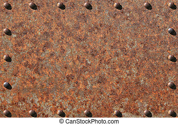 Rusted and Riveted Steel Plate - Heavily rusted metal plate,...
