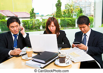 Deadline - Situated in a caf?, a group of business people...
