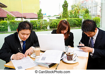 Group of business people busy signing document - Situated in...