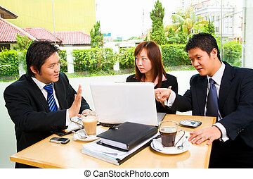Group of business people in heavy discussion - Situated in a...