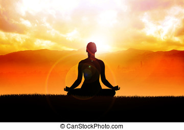 Meditation - Silhouette of a woman figure meditating in the...