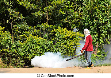 Fogging to prevent spread of dengue fever - man Fogging to...