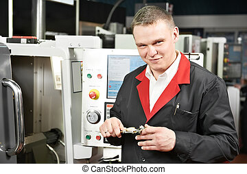 worker measuring detail with caliper - mechanical technician...