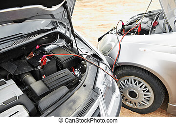 starting car engine with battery jumper cables - Starting...