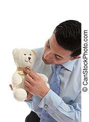 Salesman holding a teddy bear