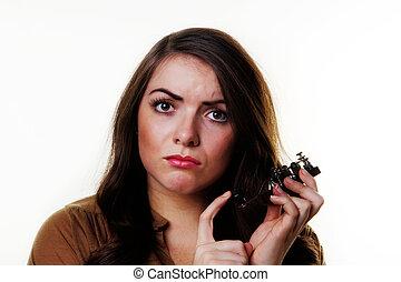 morse code key - woman holding a morse code key