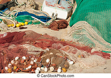 Fishing tackle in a variety of colors on a pier