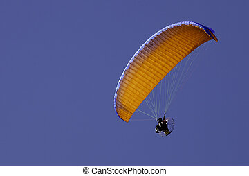 Powered paraglide - Orange powered paraglide or paramotor...