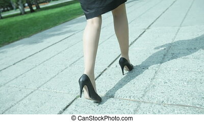 Business stilettos - Determined businesswoman walking the...