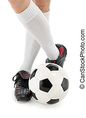 Football player's feet with the ball