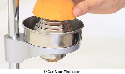 Squeezing orange juice with large juice press machine