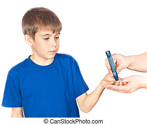 The boy is doing a test for diabetes. Photo isolated on...