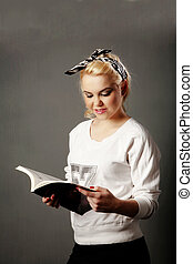 text book and girl - young girl in casual clothing with text...