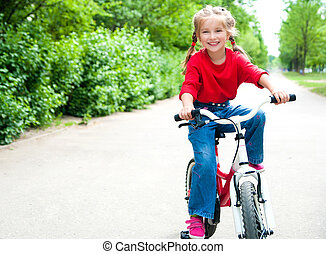 girl with bicycle - little girl with her bicycle