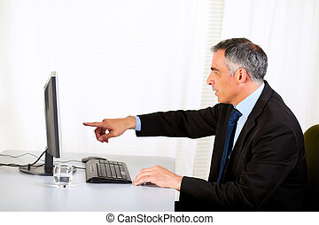 Businessman pointing the computer