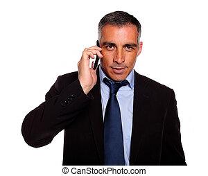 Hispanic professional businessman conversing - Portrait of a...