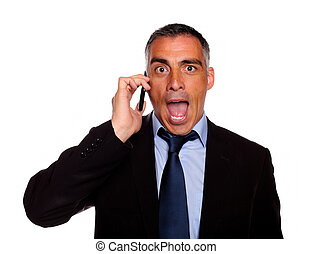 Surprised business man on cellphone - Portrait of a...