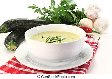 Zucchini creme soup - a bowl of zucchini creme soup with...