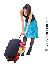 Woman dragging suitcase - Full body of an attractive woman...