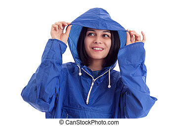 young women in a blue rain coat is looking up