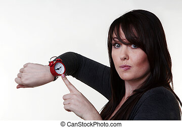 what time do you call this - woman looking a watch thinking...