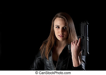 Security girl with gun Isolated on black