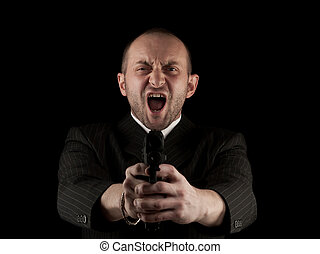 Angry Man Holding Gun and screaming, isolated on black