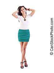 Young girl posing in short skirt. Isolated over white...