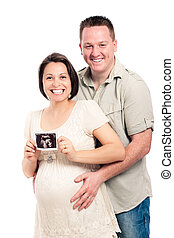 Happy pregnant couple with ultrasound picture - Portrait of...