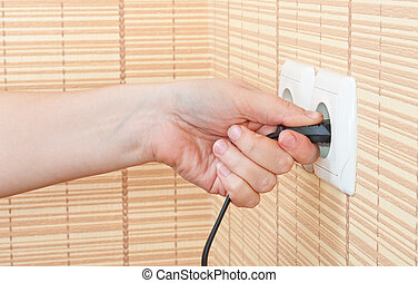 Hand insert the plug into the power
