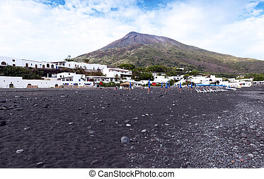 Stromboli Island - Stromboli volcano and black sand beach...