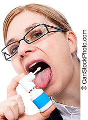 Woman with sore throat using oral spray