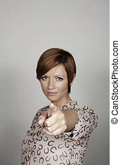 pointing - good looking woman pinting her finger at...