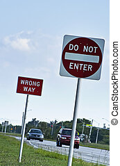Wrong way street signs - Wrong way and do not enter street...