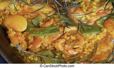 spanish typical paella with pilgrim - Preparing spanish...