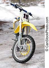 Motocross bike - New yellow motocross bike on ice and snow...