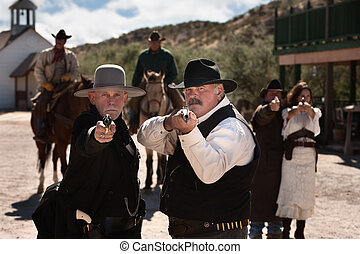 Tough Gunfighters With Weapons - Brave men aim their guns in...