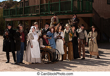 People outside a building in old west costumes - Townspeople...